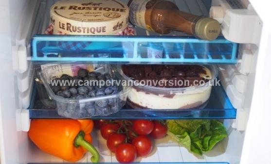 A well filled campervan fridge